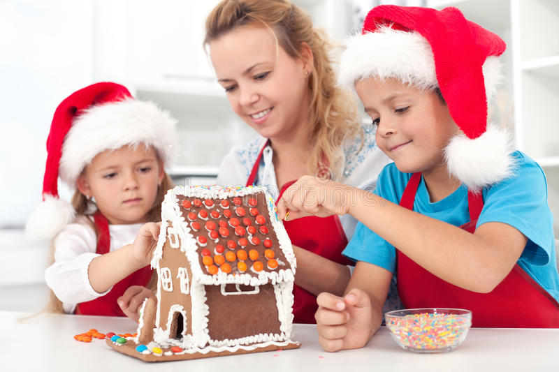 Preparing a gingerbread cookie house stock image