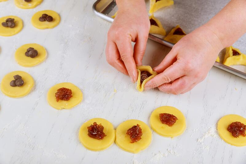 Preparing hamantaschen cookies for Purim. Jewish holiday concept royalty free stock photos