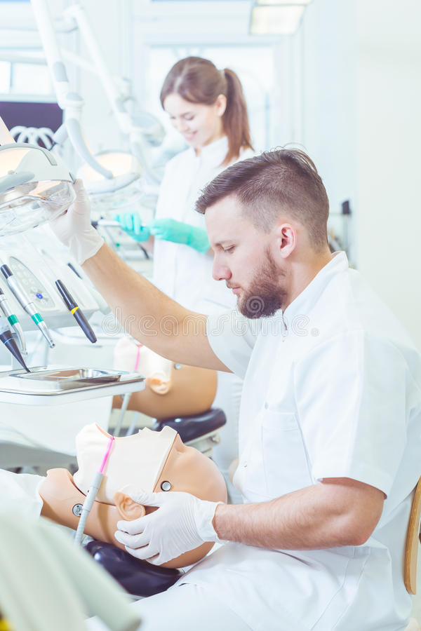 Preparing for his first real-life dental procedure royalty free stock photo
