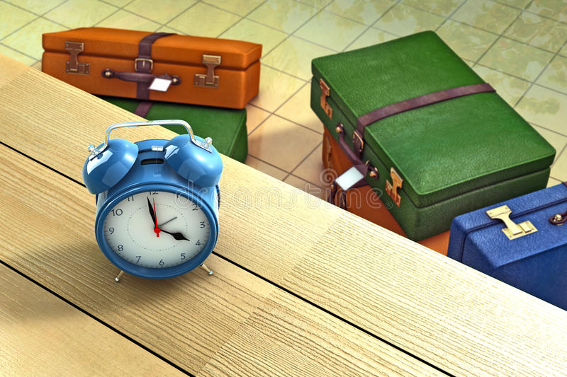 Preparing for the holidays. Alarm clock on a table with suitcases as background stock illustration