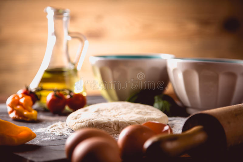 Download Preparing Home Pizza On Wooden Table With Ingredients Stock Photo - Image: 83724029