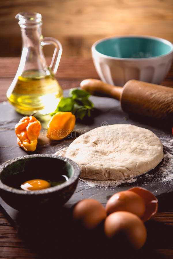 Download Preparing Home Pizza On Wooden Table With Ingredients Stock Image - Image: 83724057