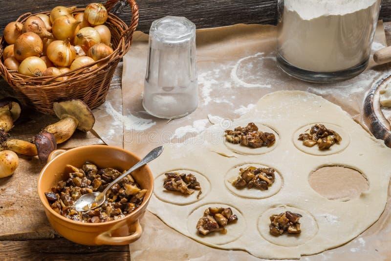 Preparing homemade dumplings with wild mushrooms royalty free stock photo