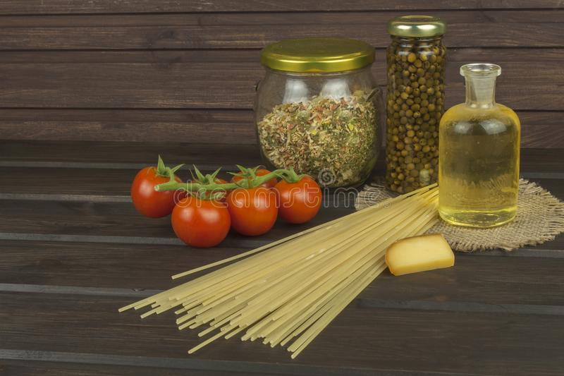 Preparing homemade pasta. Pasta and vegetables on a wooden table. Dietary food royalty free stock photos