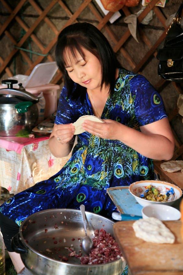 Preparing Huushuur during the Naadam, Mongolia. stock photography