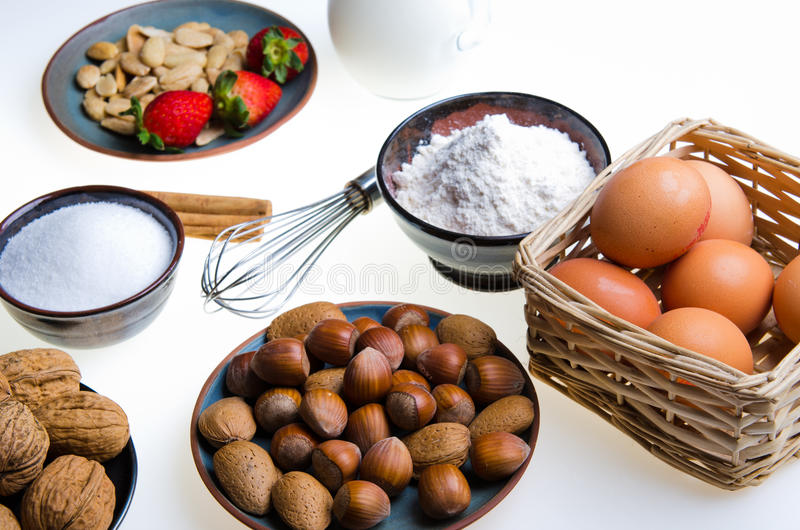 Preparing. Ingredients and tools to prepare desserts stock photos