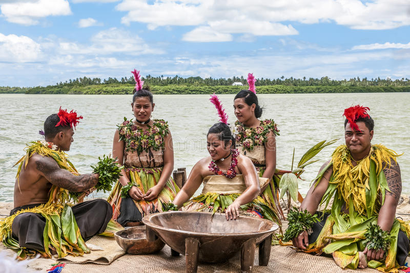 Kava Ceremony. Young people of an tropic Island (Nukualofa, Tonga) are preparing the Kava ceremony. The daughter of the headman of the tribe leads the