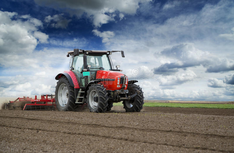 Preparing land for sowing. At spring, farmer in tractor royalty free stock photography
