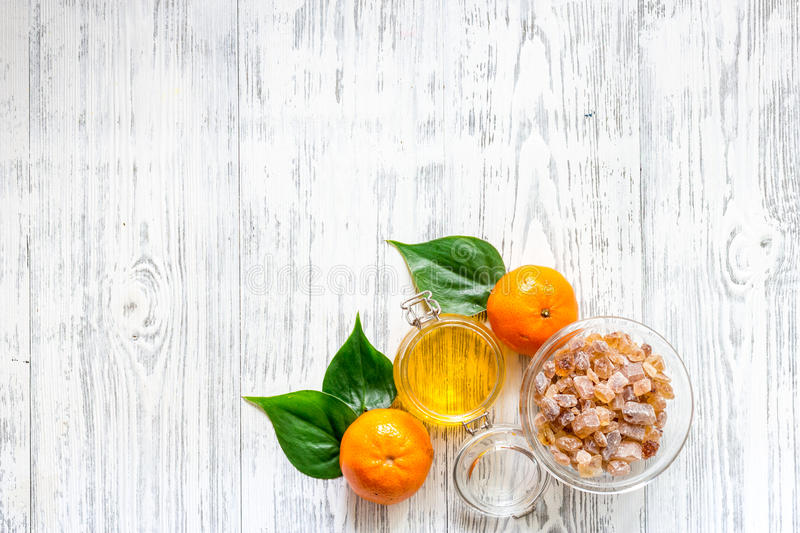 Preparing light summer dessert. Oranges, honey, sugar on wooden table background top view copyspace. Preparing light summer dessert. Oranges, honey, sugar on royalty free stock images