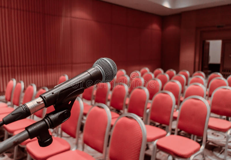 Preparing microphone on podium of conference hall or seminar room event royalty free stock images