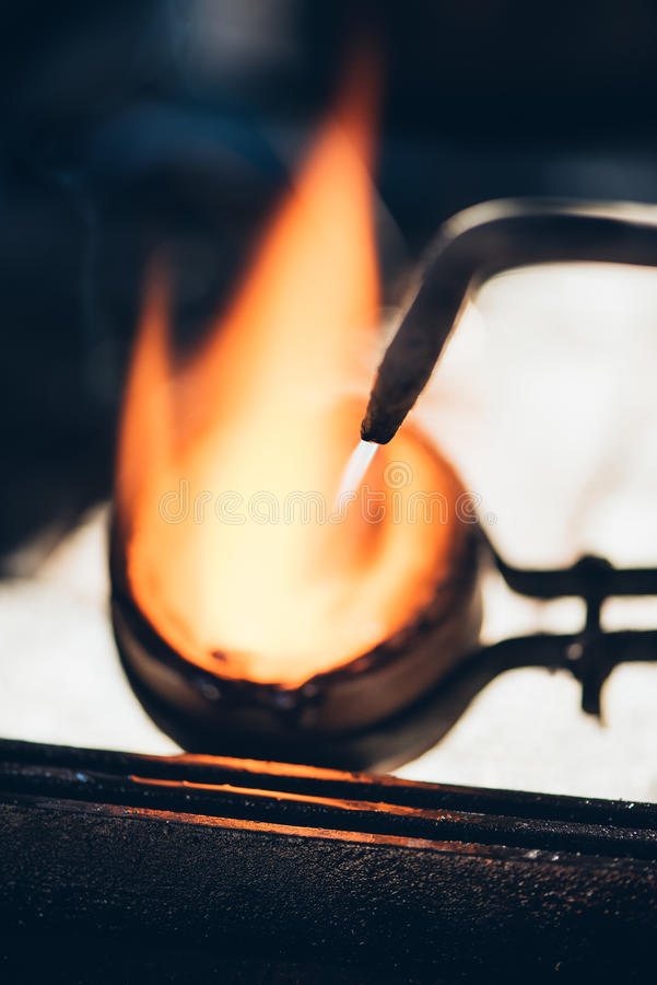 Preparing the molten metal for the mold stock image