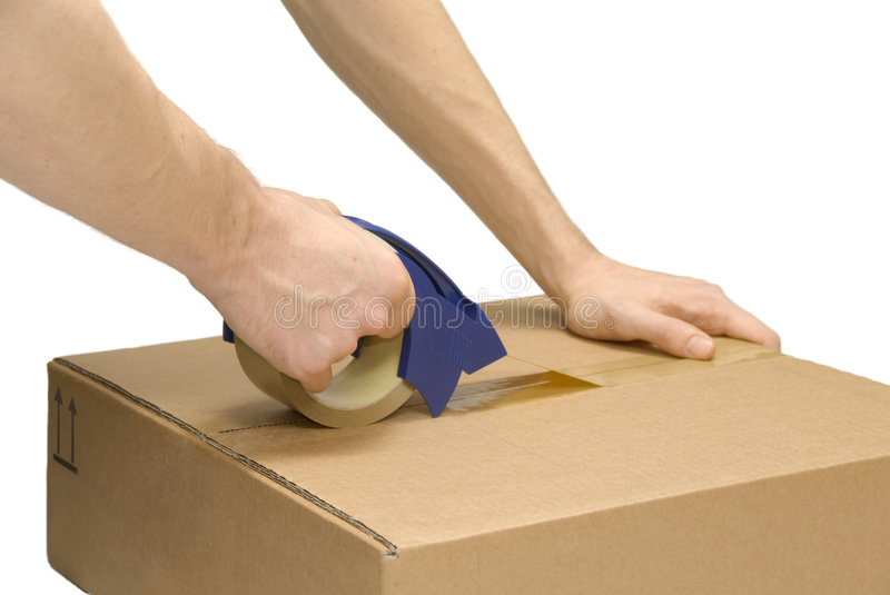 Preparing a packet. Male hands taping up a packet, isolated on pure white royalty free stock photos