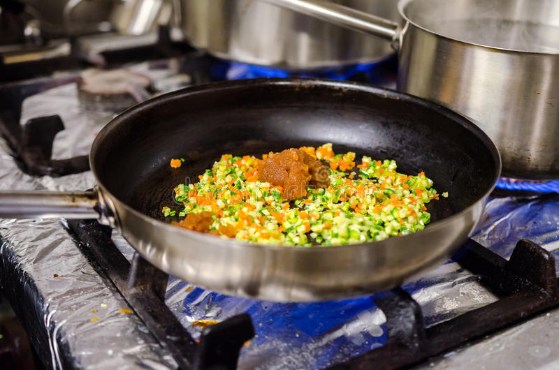 Preparing pasta sauce stock photography