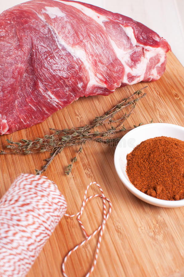 Preparing raw meat with herbs spices royalty free stock photo