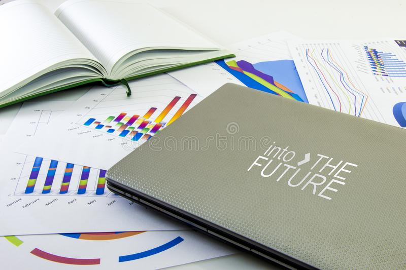 Preparing report. Blue graphs, glasses, calculator and pen. Business reports and pile of documents on gray reflection background stock photography
