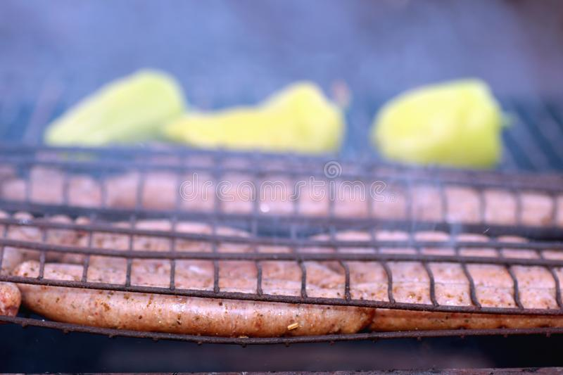 Preparing sausages on fire royalty free stock photography
