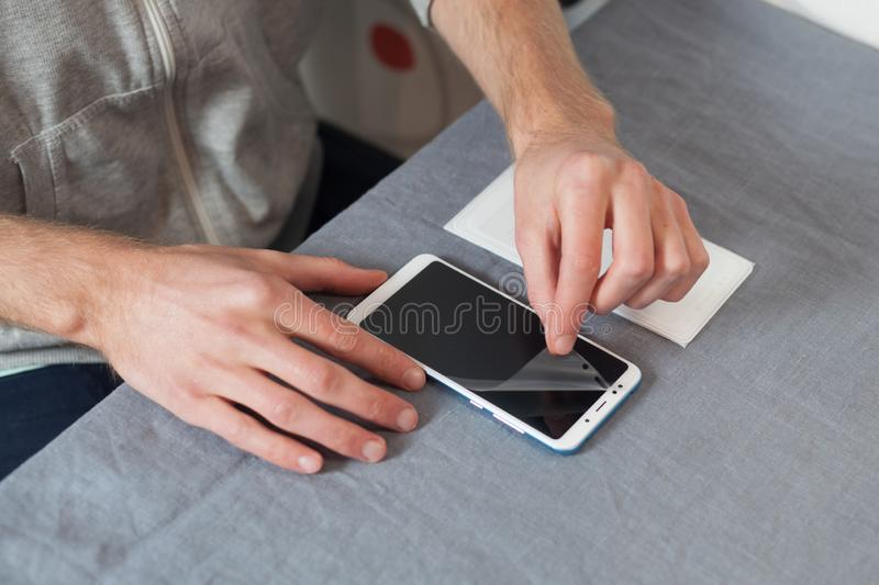 Preparing the smartphone for replacing the protective film. High royalty free stock photography