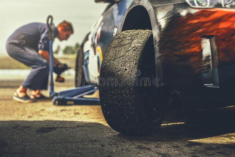 Preparing of sport car for drift race. Mechanic is change wheels of sport car for drift race royalty free stock image