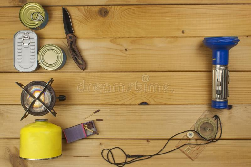 Preparing for summer camping. Things needed for an epic adventure. Sales of camping equipment. Packaging equipment for camping. Camping equipment on a wooden stock photo