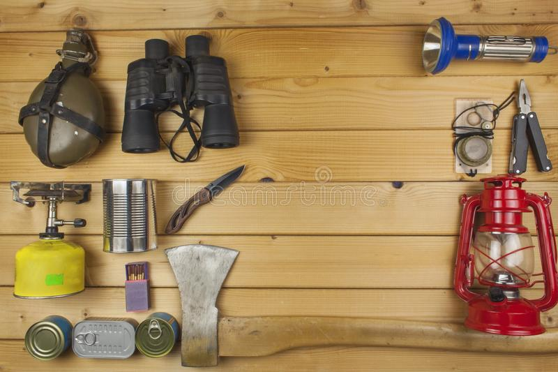 Preparing for summer camping. Things needed for an epic adventure. Sales of camping equipment. Packaging equipment for camping. Camping equipment on a wooden stock images