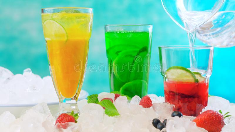 Preparing Summer Spritzer drinks with fresh fruit with sparkling mineral water. royalty free stock photos