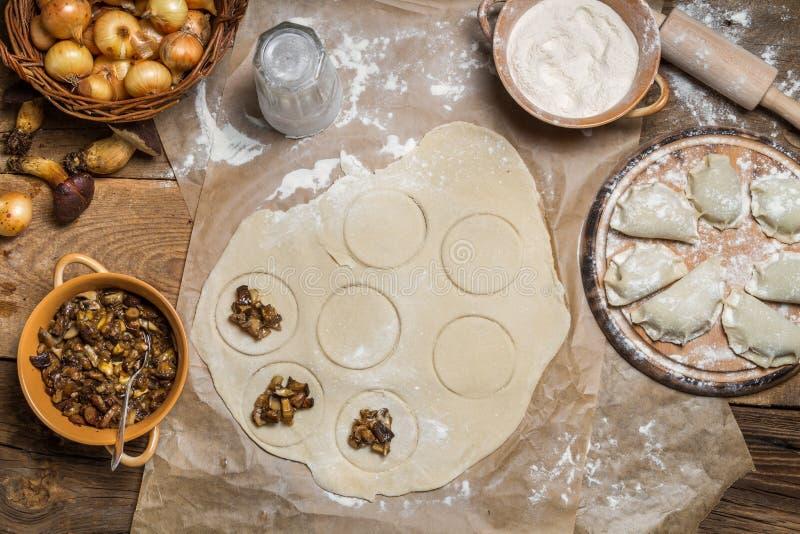 Preparing to cook homemade dumplings royalty free stock photos