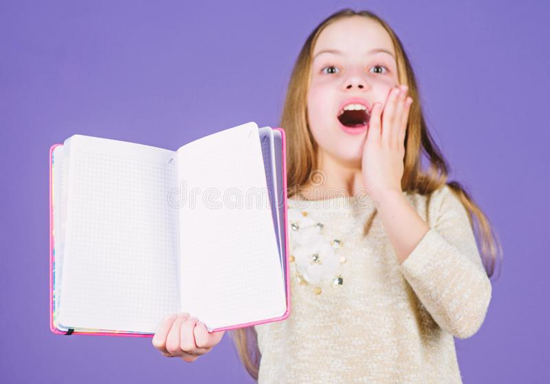 Preparing to exams in library. Happy small child holding open library book. Adorable little library reader happy smiling. With book. Reading in a school library royalty free stock photos