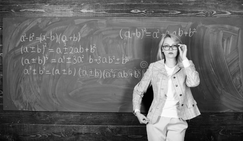 Preparing to the exams. teacher on school lesson at blackboard. woman in classroom. Study and education. Modern school. Knowledge day. Back to school. Teachers royalty free stock images