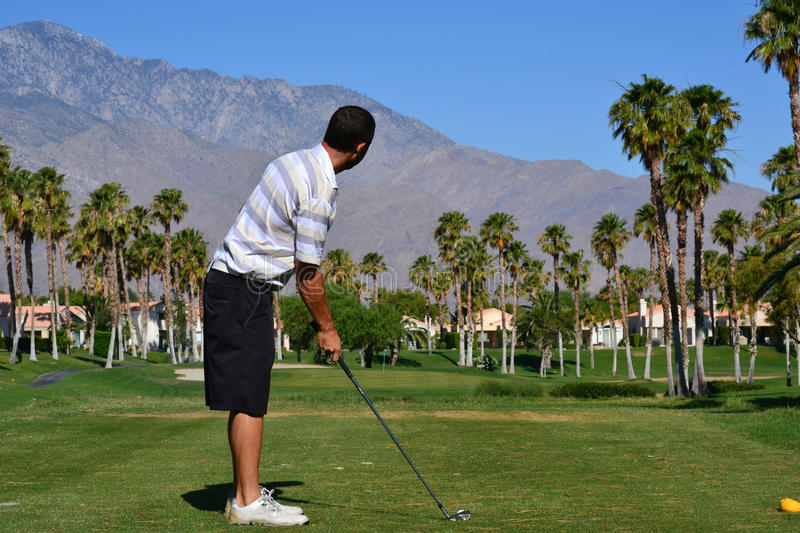 Preparing to hit a golf ball royalty free stock photography