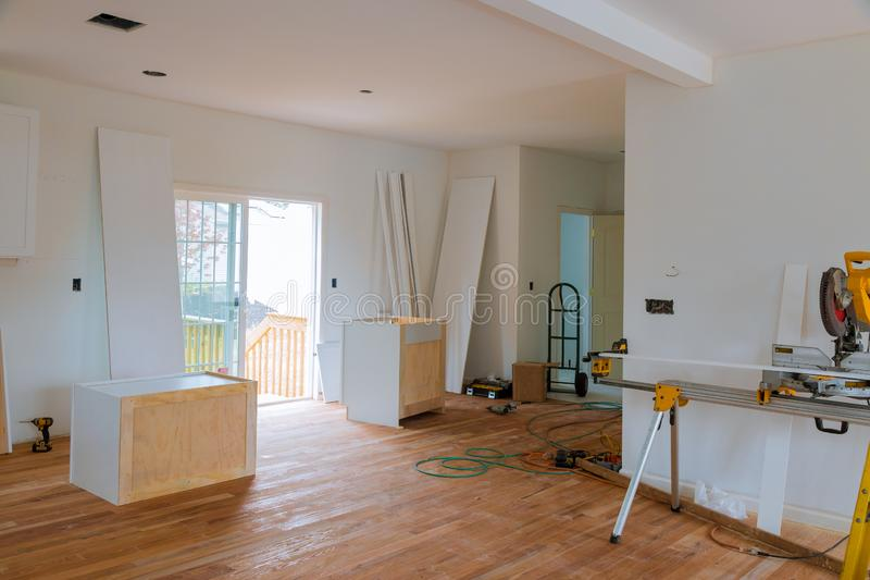 Preparing to install custom new in modern kitchen. Preparing to install custom new kitchen cabinet in modern, installing, furniture, installation, domestic, home stock images
