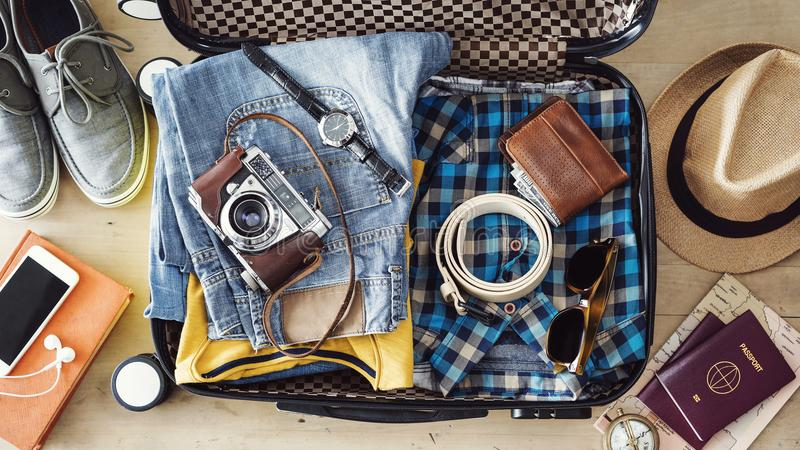 Preparing travel suitcase high angle view stock photo