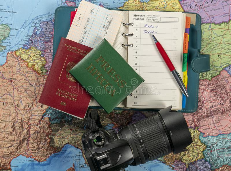 Preparing for the trip, travel. On the map is a passport, ticket, press card, notebook and camera.  royalty free stock image
