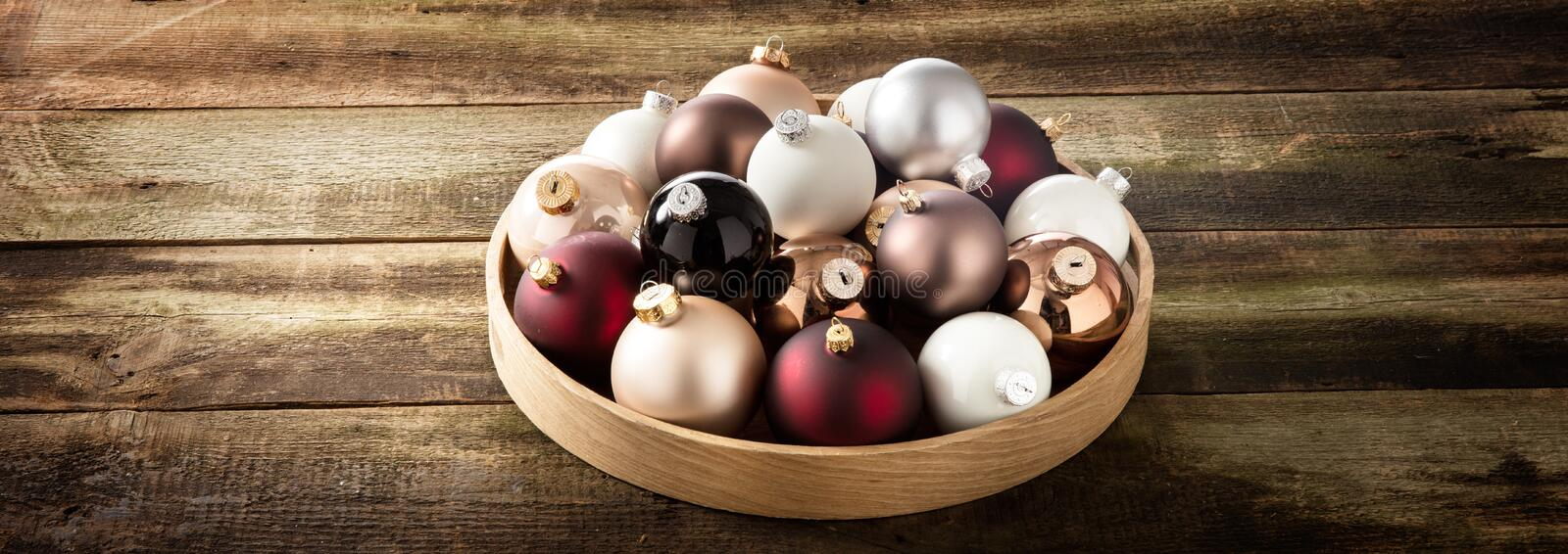 Preparing a vintage Christmas with baubles on retro wood background stock image