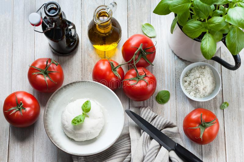 Prepping a vegan summer tomato Caprese Salad. stock images