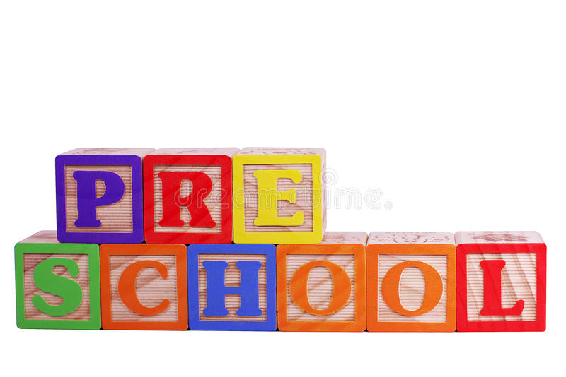 Preschool. Is spelled out in wooden letter blocks isolated on white with clipping path royalty free stock photos