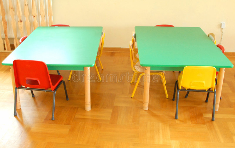 Preschool. Two colorful kinder tables with chairs stock photography