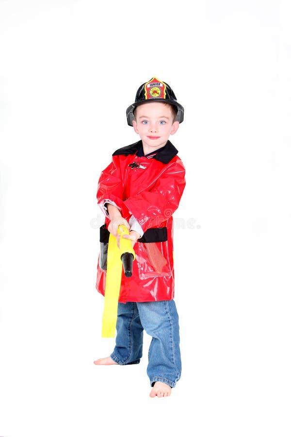 Preschool age boy in fireman costume royalty free stock photo