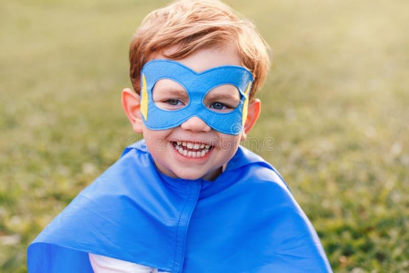Preschool Caucasian child boy playing superhero royalty free stock photo