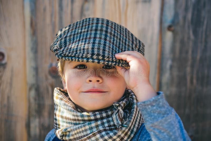 Preschool child. Boy face. Elegant child. Autumn weather. People, adorable kid, funny portrait. Cap, hat and scarf. royalty free stock images