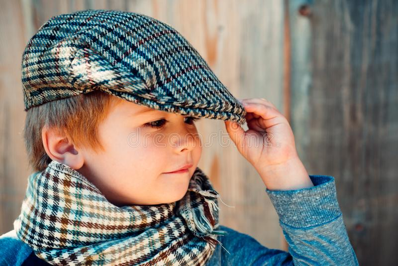 Preschool child. Boy face. Elegant child. Autumn weather. People, adorable kid, funny portrait. Cap hat and scarf. royalty free stock photos
