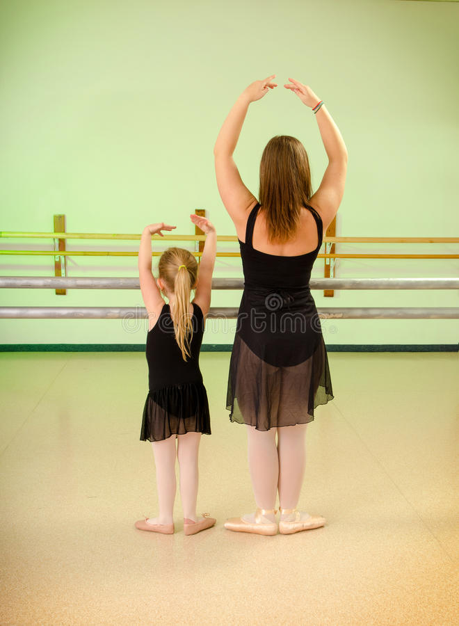 Preschool Child Dance Lesson in Studio. A Preschool Child with Teacher in Primary Ballet Class at Dance School Studio royalty free stock image