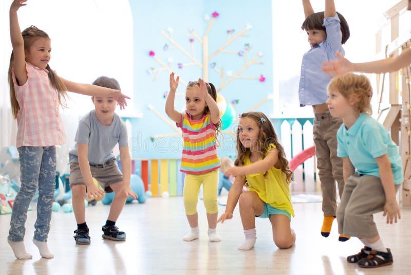 Preschool children group in daycare. Active games for kindergarten kids stock images