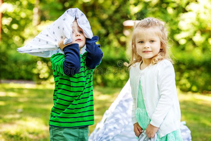 Preschool children play in the park. 2-3 years. Girl and boy. Th royalty free stock photos