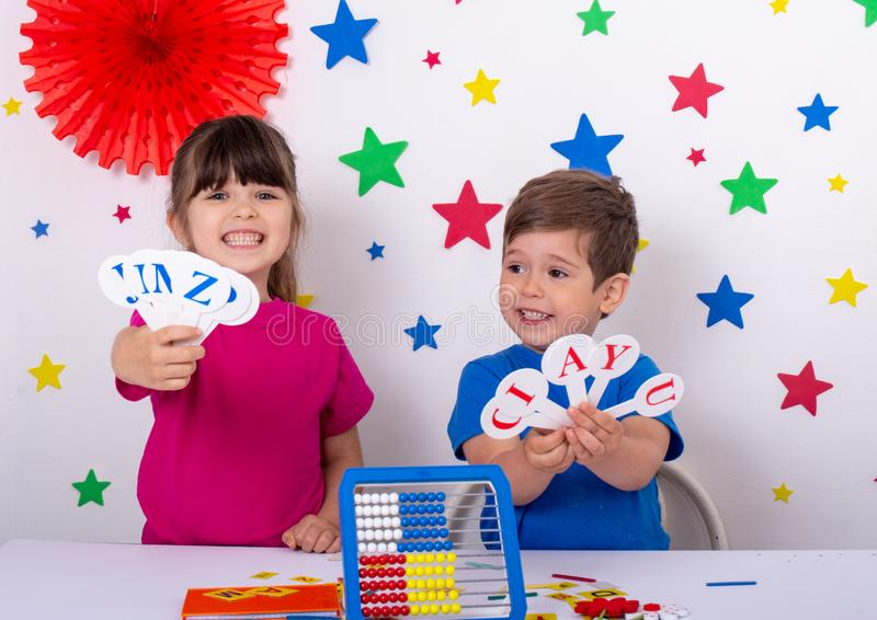 Preschool and elementary school learn english alphabet, colors, shapes. English learning for kids stock photos