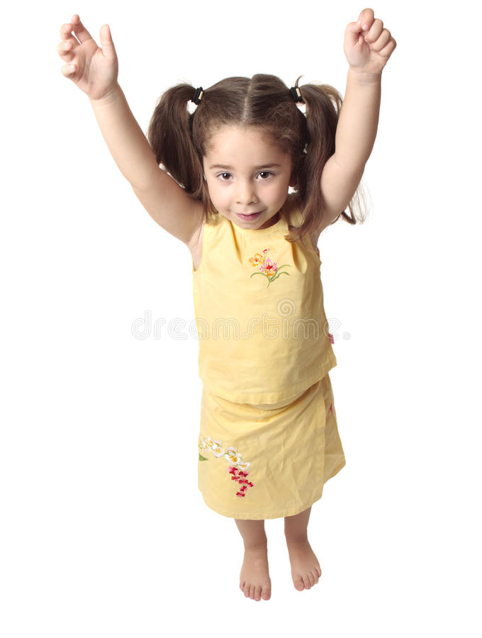 Preschool girl with arms raised above head