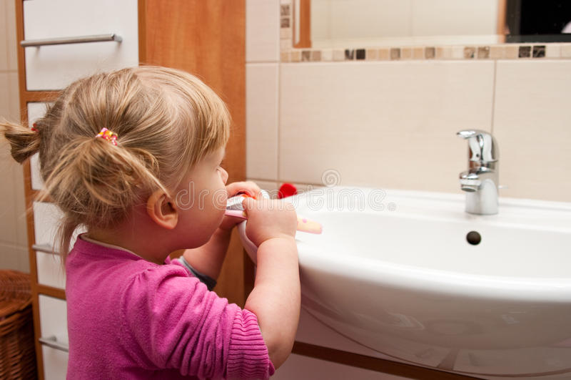 Preschool Girl Brushing Teeth Stock Photo