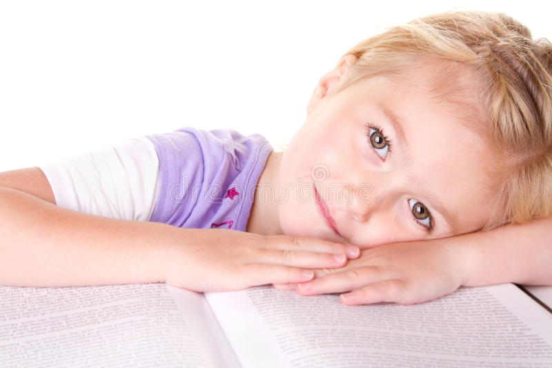 Download Preschool Girl Laying On Large Book Stock Photo - Image: 25366068