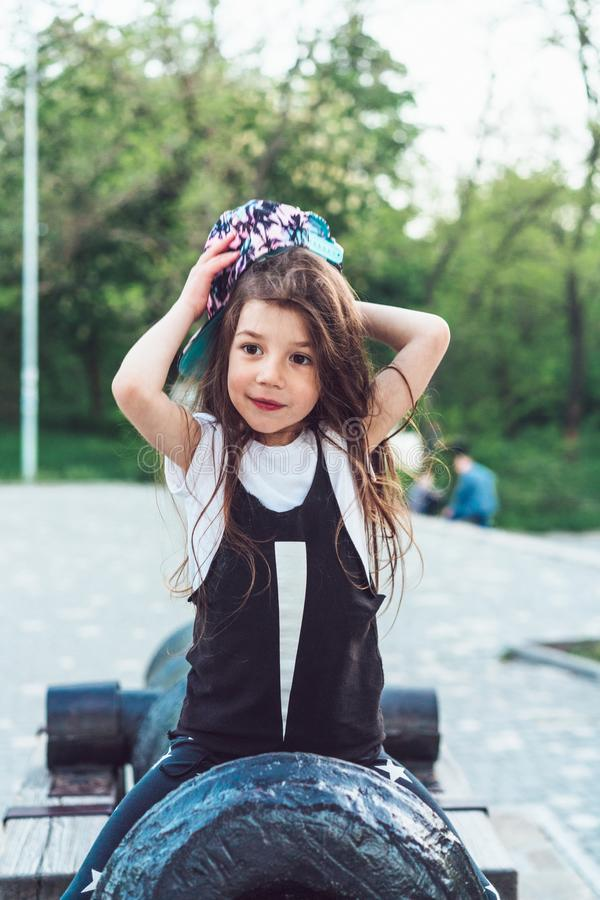 Free Preschool Girl Sitting On Top Of A Cannon Royalty Free Stock Photos - 106664298