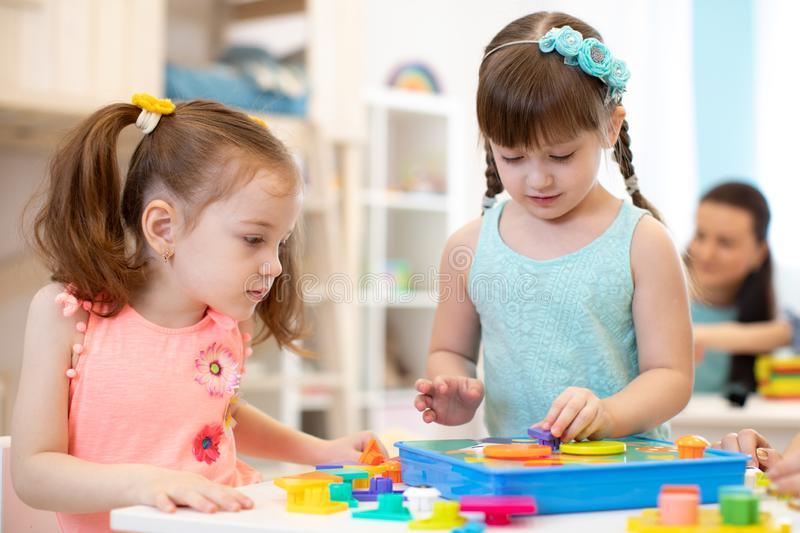 Preschool kids learning shapes, early education and daycare concept royalty free stock photos