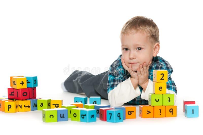 Preschool little boy with blocks royalty free stock photo
